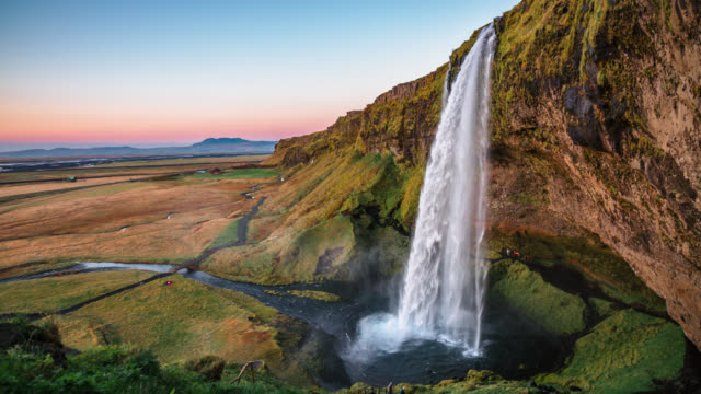slow motion shot of seljalandfoss waterfall in iceland - seljalandsfoss waterfall stock videos and b-roll footage