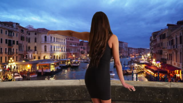 slow motion shot of sexy latin woman in a black dress dancing in venice - black dress stock videos & royalty-free footage