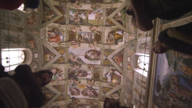 slow motion shot of silhouetted figures in the sistine chapel - female likeness stock videos & royalty-free footage