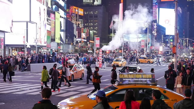 Slow motion shot of steam and traffic in NYC Manhattan Times Square