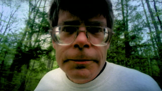 slow motion shot of stephen king looking down the lens of the camera - langsam stock-videos und b-roll-filmmaterial