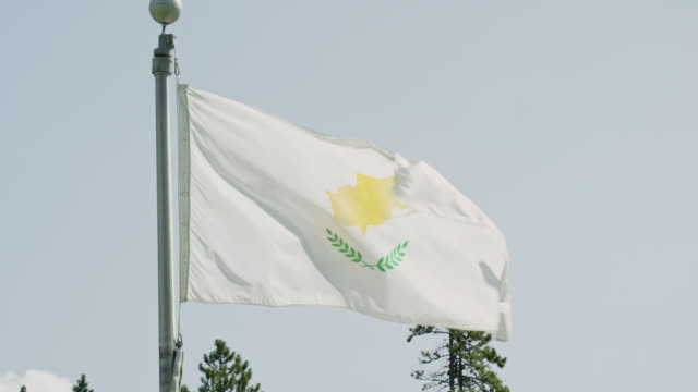 slow motion shot of the flag of cyprus blowing in the wind on a sunny day - identity politics stock videos & royalty-free footage