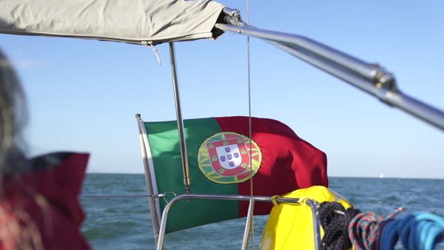 slow motion shot of the portuguese flag on the back of a boat - traditionally portuguese stock videos & royalty-free footage