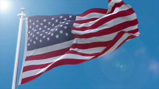 slow motion shot of the united states flag with lens flare - pole stock videos & royalty-free footage