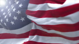 Slow motion shot of the United States flag with lens flare