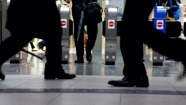 slow motion shot of traveler crowd at shin osaka station gate, japan - station stock videos & royalty-free footage