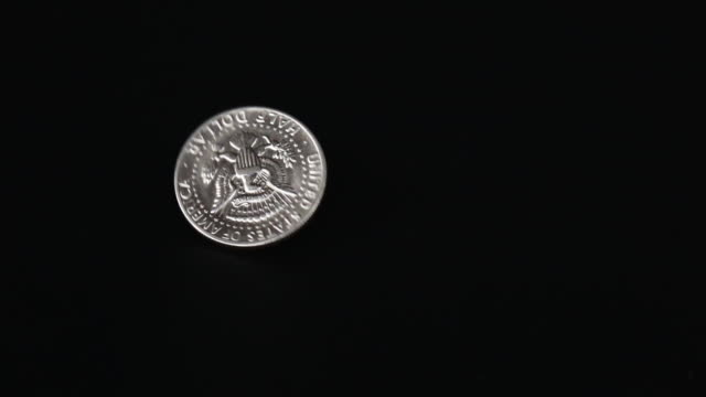 slow motion shot of us 50 cent coin - us coin stock videos & royalty-free footage