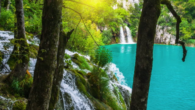 Slow motion shot of waterfalls in in the stunning nature of Plitvice Lake National Park