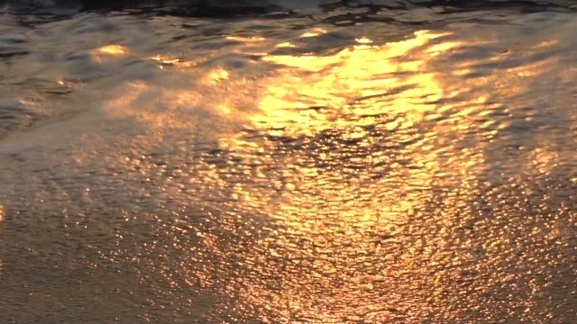 slow motion shot of waves on the beach - rolling stock videos & royalty-free footage