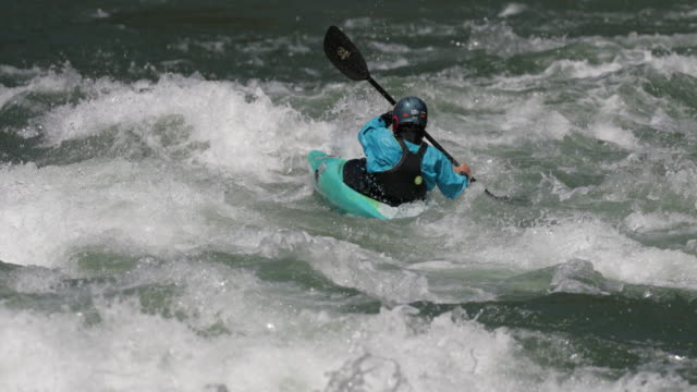 ms 4k slow motion shot of white water rafters/kayakers on the snake river, wyoming - rafting stock-videos und b-roll-filmmaterial