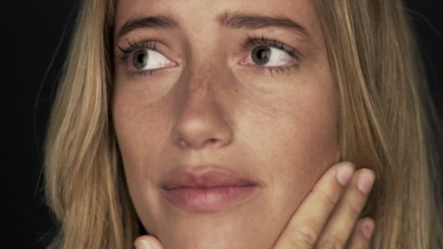 slow motion shot of woman covering face in shame - augen zuhalten stock-videos und b-roll-filmmaterial