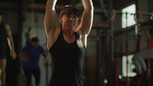 slow motion shot of woman lifting kettle bell in cross training gymnasium / lehi, utah, united states - lehi stock videos & royalty-free footage