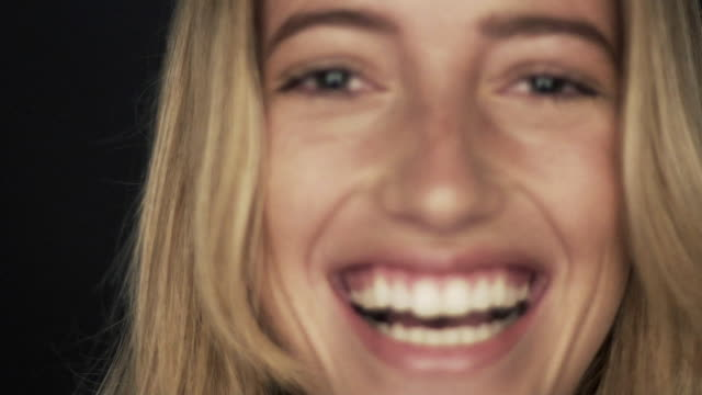 slow motion shot of woman smiling and laughing - blonde hair stock videos & royalty-free footage