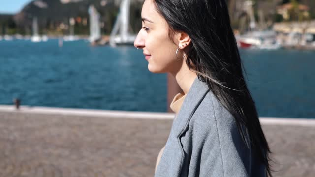 slow motion shot of woman with nose piercing walking at harbour - nose piercing stock videos & royalty-free footage