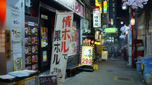 slow motion pov shot of yakitori alley, tokyo - retail place stock videos & royalty-free footage