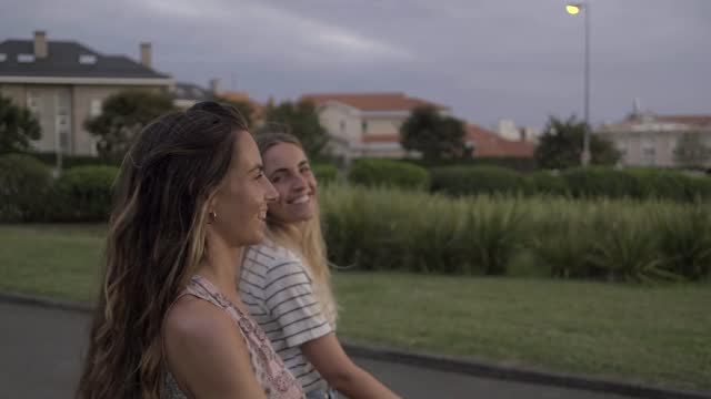 slow motion shot of young women walking in park - two people stock-videos und b-roll-filmmaterial