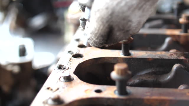 Slow Motion Shot, Using Air Impact Wrench to Screwing Rusty Bolts in Workshop