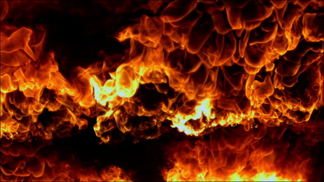vídeos y material grabado en eventos de stock de slow motion shots of bright red flames - fire