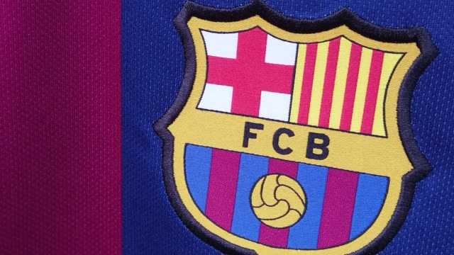 slow motion showing official barcelona fc club badge on a home shirt blowing in the wind - striped stock videos & royalty-free footage