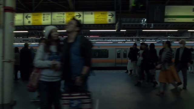 slow motion. side point of view. shot of passenger train scenery. tokyo, japan - 駅点の映像素材/bロール