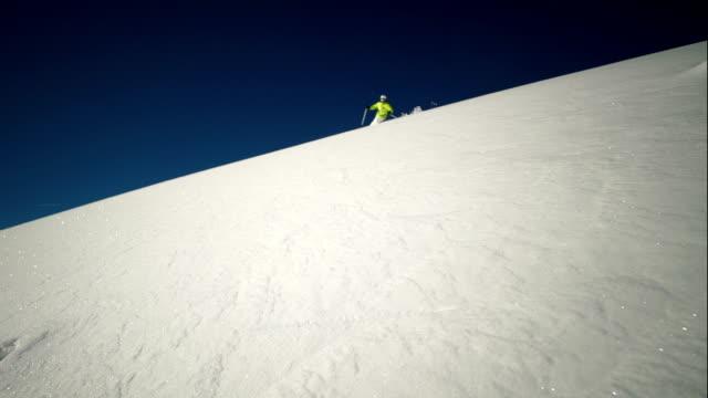 slow motion ski turn in powder snow - ski jacket stock videos and b-roll footage