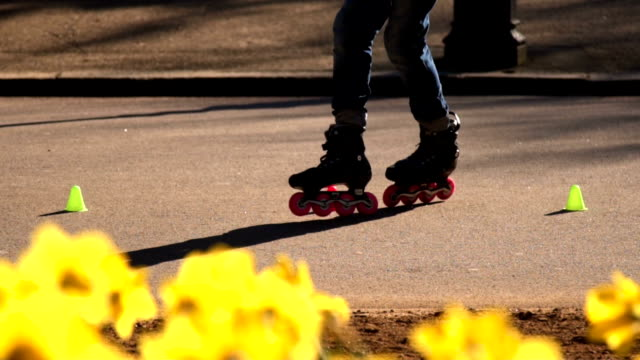 Slow motion: Slalom Skating In Hyde Park London Close-up