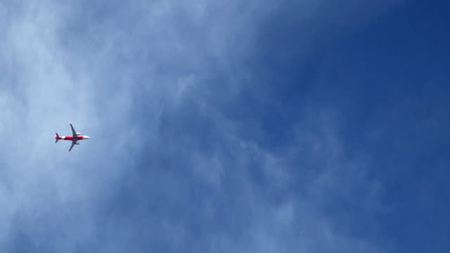 slow motion small airplane flying in the blue sky - mack2happy stock videos and b-roll footage