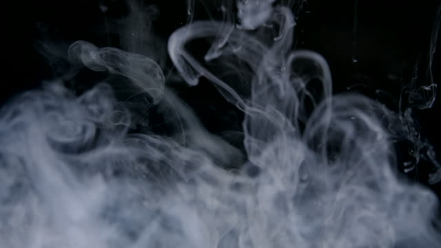 slow motion smoke cloud liquid colour ink in water - smoke physical structure stock videos & royalty-free footage