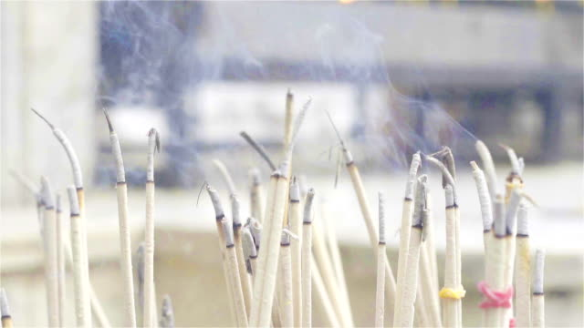 slow motion: smoke of incense - incense stock videos & royalty-free footage