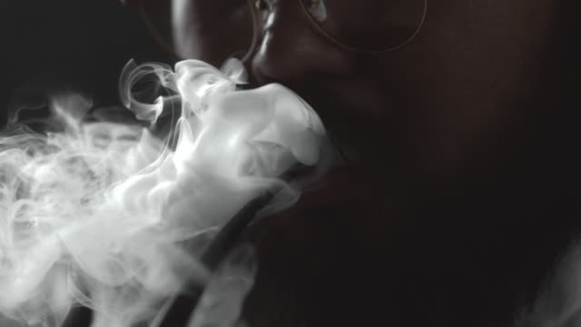 slow motion  : smoking - narcotic stock videos & royalty-free footage