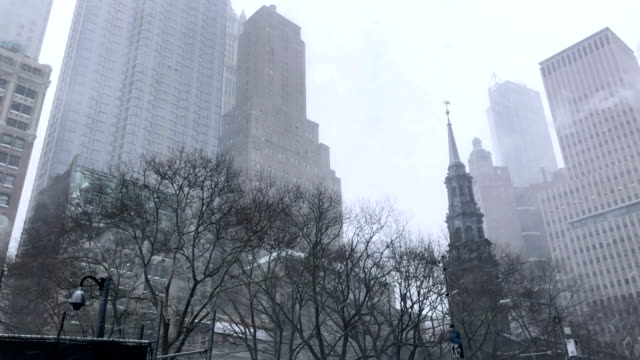 slow motion - snowing in new york city - falls church stock videos & royalty-free footage