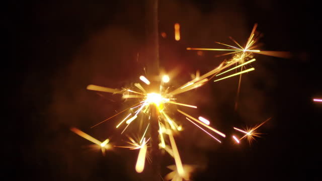 slow motion sparkle - sparkler stock videos & royalty-free footage