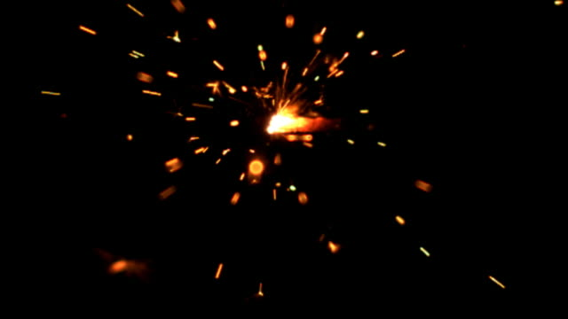 Slow motion sparkler burning
