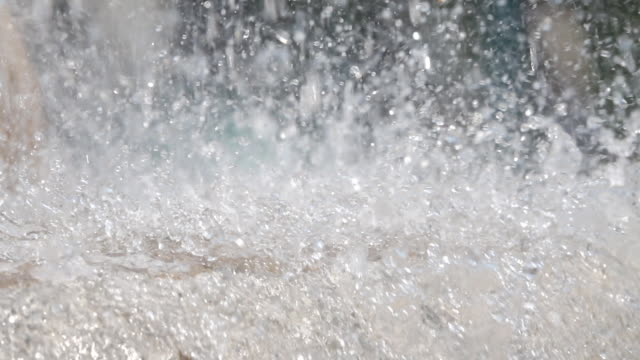Slow motion: Splashing streams of water fountain