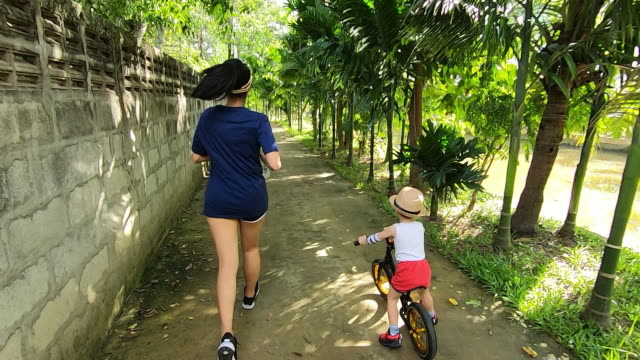 slow motion, sport mom and son exercise togetherness