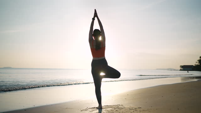 slow motion sport woman practicing yoga at sunsetpeople, vacation,healthy,travel,lifestyle - lotus position stock videos & royalty-free footage