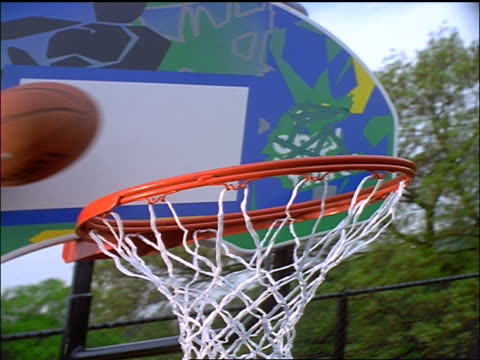 slow motion stretched close up basketball being thrown thru hoop outdoors - generic location stock videos & royalty-free footage