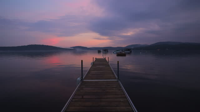 slow motion summer sunset at the lake - symmetry stock videos & royalty-free footage
