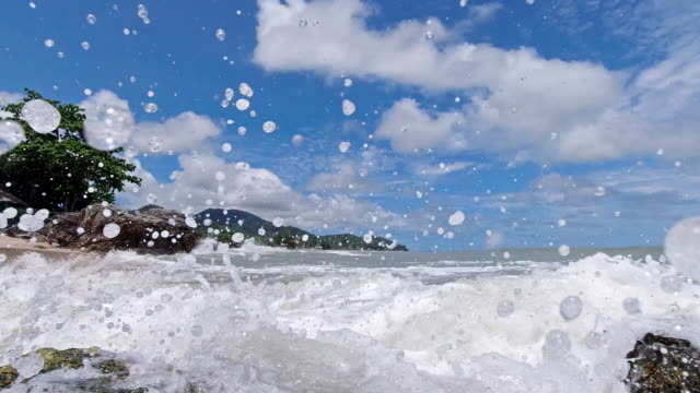 slow motion surf waves splashing on camera tropical paradise island asia - wide angle stock videos & royalty-free footage