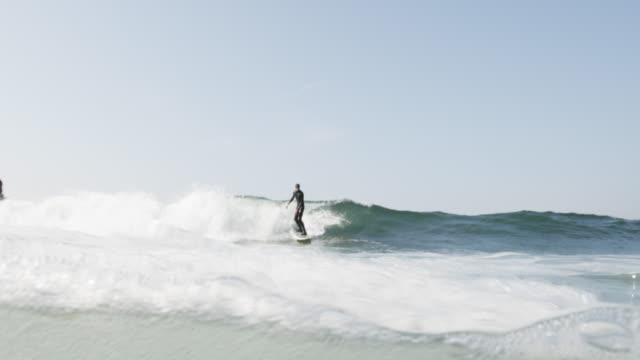 slow motion, surfing in california - surfing stock videos & royalty-free footage