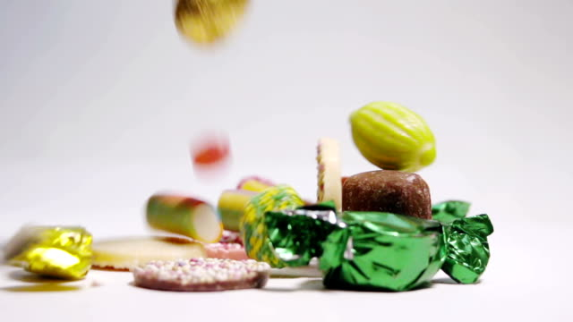 slow motion sweets falling - confectionery stock videos & royalty-free footage