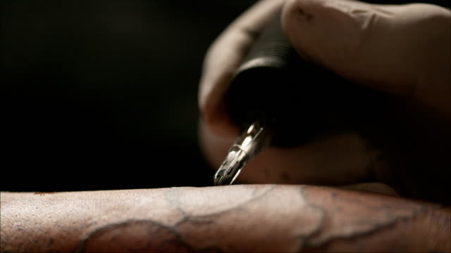 slow motion tattoo - tattoo stock videos & royalty-free footage