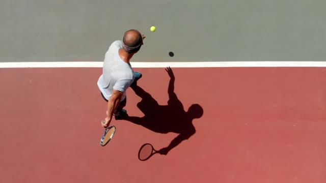 vídeos de stock, filmes e b-roll de tenista de câmera lenta - equilíbrio