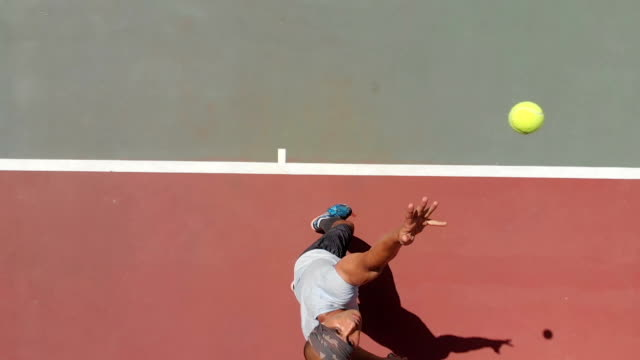 slow motion tennis player - tennis racket stock videos & royalty-free footage
