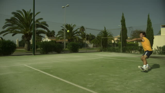 slow motion tennis player winding up and hitting forehand, spain (individual frames may also be used as a still image. each frame in its raw state is about 6mb or about 12mb as a 16 bit tiff) - forehand stock videos & royalty-free footage