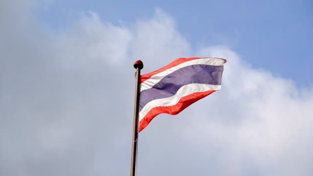 slow motion thai flag with blue sky background - politics illustration stock videos & royalty-free footage