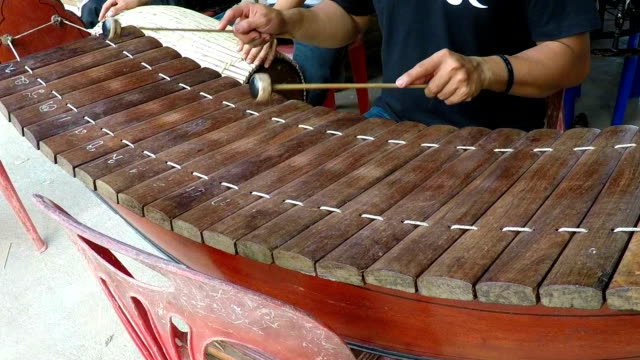 Slow Motion: Thai wooden alto hands musician playing the xylophone