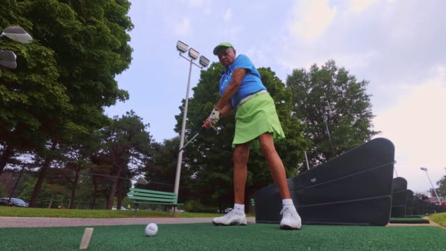 slow motion: the active, optimistic 77-years-old senior black woman playing golf - putting stock videos & royalty-free footage