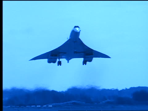 blue slow motion tilt down concorde airliner approaching + landing on runway - british aerospace concorde stock videos and b-roll footage