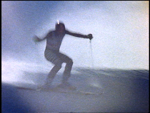 slow motion tilt down german downhill skier skiing around poles in slalom - slalom skiing stock videos & royalty-free footage